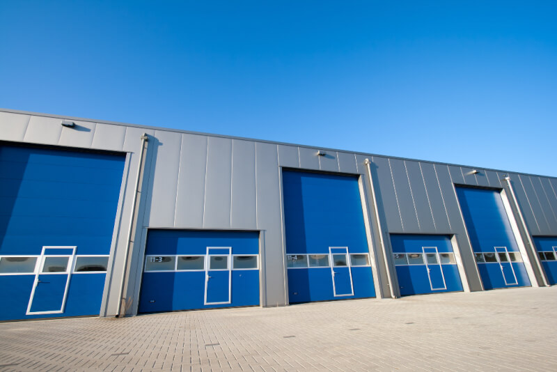 steel building with insulated metal panels and lots of overhead doors